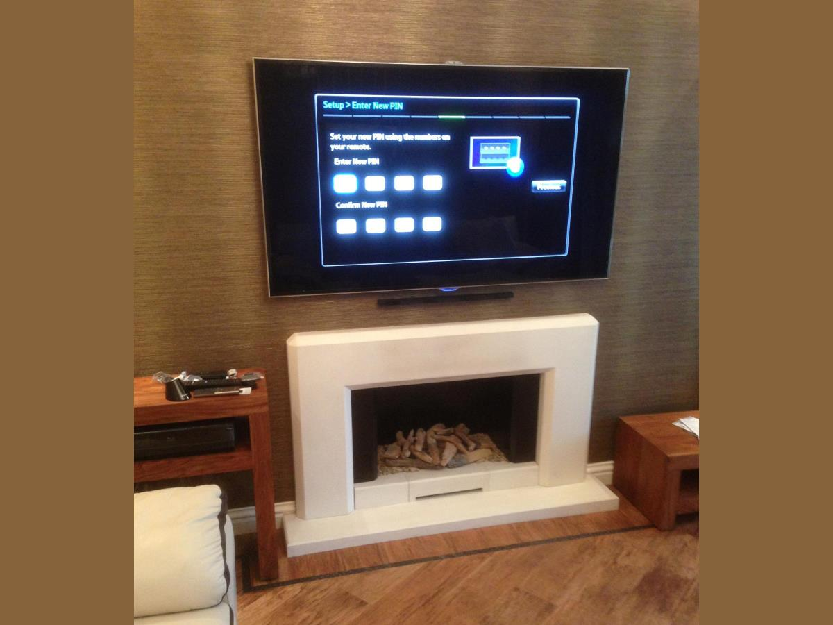 "Pre-Cabling and finished recess wall mounted Sony AV system with 65"" Samsung Smart TV installed in Fleetwood."