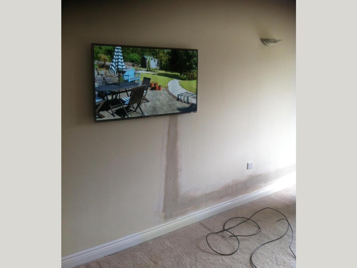 2 of 2 - Flat bracket fitted with TV mounted and channeling re-plastered.